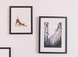 arranging photo frames on walls