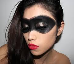 superhero makeup with black eye mask and red lips
