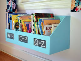 paint and repurpose an organizer as a hanging bookshelf for your kids