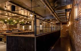 en wire glass was used to create partitions to section off areas of the restaurant while copper doors were used to ingeniously hide wall mounted