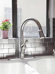 Kitchen:Kitchen With White Kitchen Sink And Curved Faucet Also Stainless  Steel Backsplash Tiles Kitchen