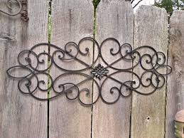black wrought iron outdoor wall art