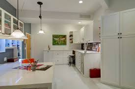 craft room lighting ideas. spacious white craft room with custom cabinetry and multiple work stations lighting ideas 1