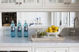 mirror kitchen backsplash kitchen fantastic kitchen bar features creamy white shaker cabinets paired with carrera marble countertops and