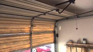 andrew and shannons beautiful chamberlien 1 2 hp garage door opener on old wooden door you