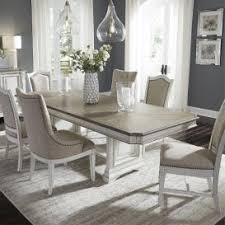 abbey park 7 piece dining room table with 4 upholstered side chairs and 2 hostess