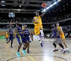 Alex Owumi of London scores with a slam dunk during the British... News  Photo - Getty Images