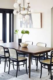 dining room wooden dining table black flower vase green plant grey carpet chandelier gl window painting fruit bowl dining chair how to design your