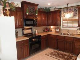 wonderful hanging pendant lighting over sink kitchen with wooden kitchen cabinets
