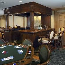 Basement baseball man cave source · poker table and home bar photo courtesy gardner fox