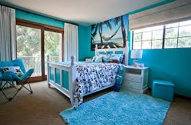 ... Tropical bedroom draped in delightful, bright blue [Design: Genoveve  Serge Interior Design]