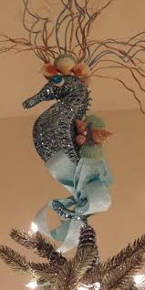 Seahorse tree topper - this is so unique! Most beach-themed trees have a