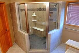 cozy bathroom with framed angle shower stall featured wall niches and corner bench also shelves tile niches in shower stalls