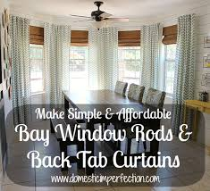 bay window rods and back tab curtains