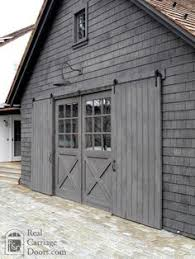 Sliding garage door hardware Horizontal With Sliding Garage Door Hardware These Real Carriage Doors Slide Open Barn Garage Pinterest 83 Best Garage Door Hardware Ideas Images In 2019 Garage Door