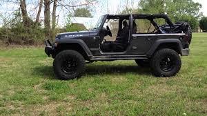 jeep wrangler jk 4 door on 37 inch nitto tires with factory rear half doors on walk around video