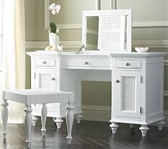 hmm.. i see two skinny cabinets with drawers, add feet, board across ...