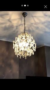 beautiful period chandelier metal sphere shaped lampshade hanging glass crystals