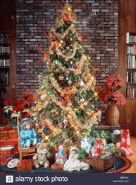 CHRISTMAS TREE WITH DECORATIONS GARLAND LIGHTS TOYS AND PRESENTS UNDER TREE
