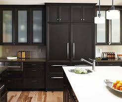 Black kitchen cabinets are unexpected and create a modern, sophisticated  look. The rich black stain on these cabinets emphasizes the clean lines, ...