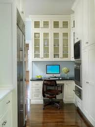 office in kitchen. a small home office is incorporated into the design of this traditional kitchen fresh white cabinets make space which situated in o