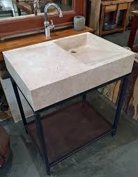 vanity and sink combination hand crafted from a single piece of white creamy marble on a