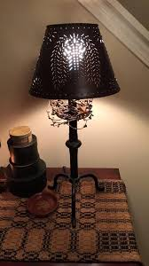 primitive lighting ideas. primitive lamp shade out of punched tin lighting ideas