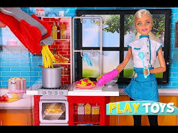barbie doll is cooking play doh dinner