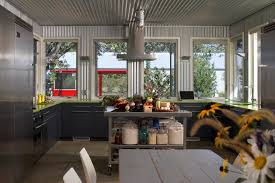 barn tin walls kitchen industrial with glass jars metal ceiling