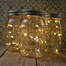 DIY :: Mason Jar Fairy Lights :: Run a small strand of battery-operated  fairy lights (available very inexpensively on eBay) into the jar & tape (or
