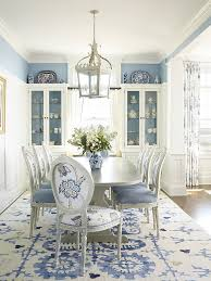beach style dining room in cly blue and white design austin patterson disston architects