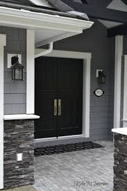 painted double front door. Exterior Of Home With Chelsea Gray Painted Shakes, Black Double Front Door And White Trim Dark Charcoal Ledgestone A