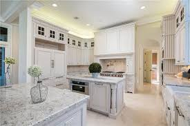 beautiful white kitchen cabinets: luxury country kitchen with white cabinets and white venatino marble countertops with island and peninsula