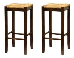 Pair of tiki style stools with wood frames and twine seats