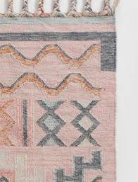who else loves a good pink rug and i think this one would read very very neutral plus the indoor outdoor quality coupled with the point reads