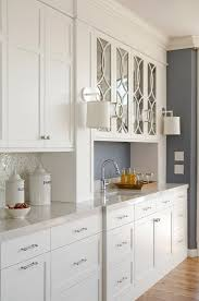 gorgeous butler s pantry features white cabinets paired with silestone lagoon countertoposaic tiled backsplash next to glass front cabinets accented
