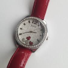 beautiful guess watch on red leather strap stones all around and red hearts inside pre loved worn only few times great valentine s day present