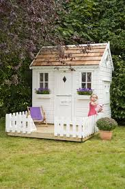 lawn garden amazing white modern painted wood backyard garden playhouse design ideas with white rectangle painted wood door also double window added
