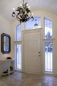 foyer with console table and a chandelier