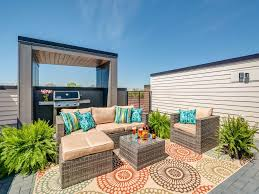 rooftop furniture. Deck - Rooftop Furnished With Rattan Furniture, Potted Ferns And A Covered Grill Area Furniture