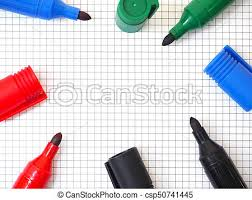 Marker Pens On Graph Paper Background Top View