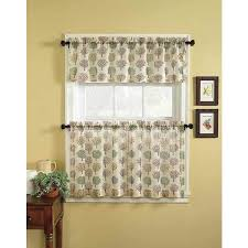 the charming orchard window tier curtain and valance set features a nature inspired tree motif on