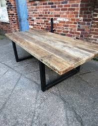 here is our 10 12 seater dining table made from reclaimed timber and 70x70mm steel the top is made from solid 2 1 2 thick timber