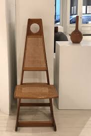 Menna chair designed by Sergio Rodrigues. Available at ESPASSO. Midcentury  modern Brazilian design.