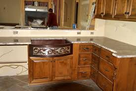 picture of 33 copper farmhouse sink with nickel two tone scroll