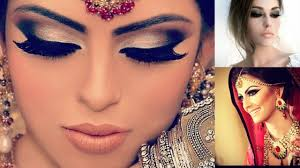 full indian airbrush bridal makeup with glittery eyes and pink lips