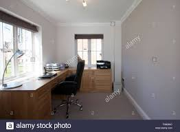 home office for two. A Home Office Or Study With Desk And Two Windows For