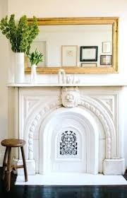 round mirror above fireplace small living room remodeling with black and white color scheme dark brown