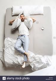 top view photo of young man sleeping in a big white bed top22 white
