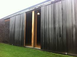 barn sliding garage doors. Example Of A Large Mountain Style Detached Barn Design In New York Sliding Garage Doors O